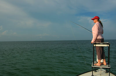 Charity Rutter fly fishes for tarpon