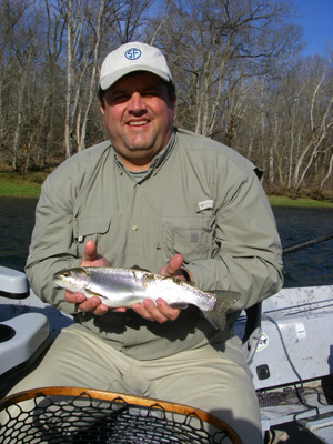 Fly fisher with rainbow trout on Tennessee's Holston River