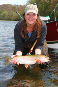 Charity Rutter with Rainbow Trout and drift boat on Tennessee's Holston River