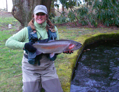 Charity Rutter with trophy rainbow trout in North Carolina