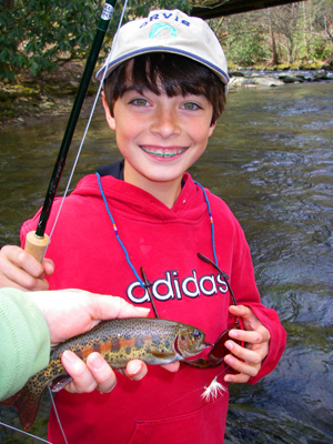 Daniel with his first rainbow trout
