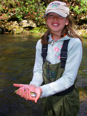 Darcy with her first brown trout