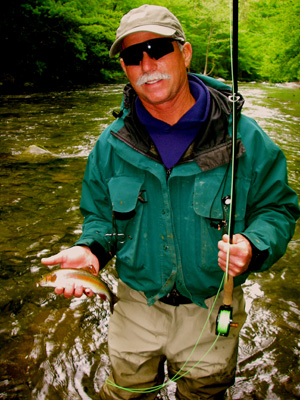 Fly fisher with Smoky mountain rainbow trout