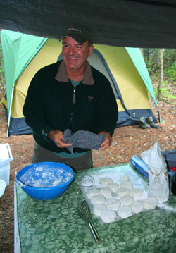Eggs, bacon, sausage, biscuits, and pancakes are all made for breakfast in camp