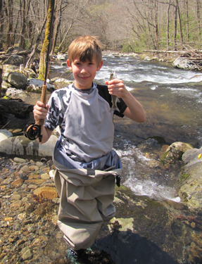 Miles Duncan of Knoxville shows off his first trout in the Smoky Mountains