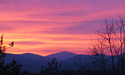 Sunrise over the world headquarter of R & R Fly Fishing in the Smokies. That's the silhouette of Mount Leconte in the distance.