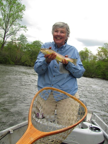 Angler with a Tuckaseegee River brown trout