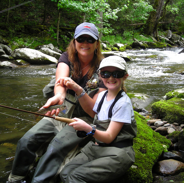 First trout for a young fly fisher