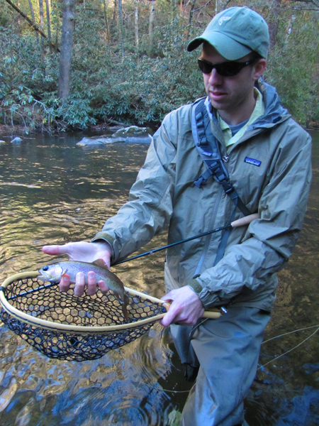 Abrams Creek fy fisher with rainbow trout