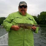 Harry Frederick with a nice smallmouth that took a brown and ginger Clouser Minnow