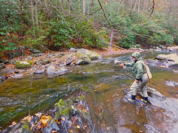Lynn Roloff fishes Little River as big snow flakes fall