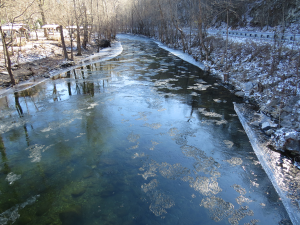 Ice floats down Little River along Tremont Hills Campground just downstream of the park line