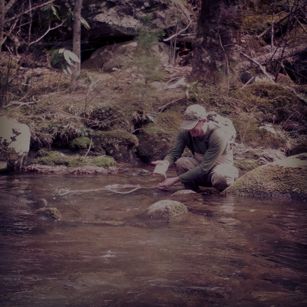 Tom Moak who fished with Charity prepares to release a chunky wild rainbow trout