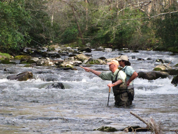 An angler gets a drift to a quiet pocket over swift rapids with a Tenkara rod when his fly rod couldn't get the drift.