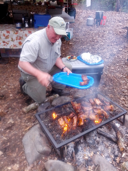 Steve's BBQ ribs come off the grill in camp