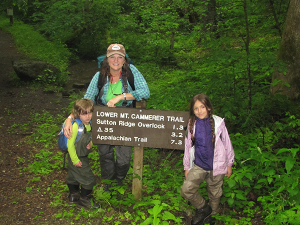 Charity, Boone, and Willow at the trailhead where they hiked in to help collect brook trout to take to their home stream