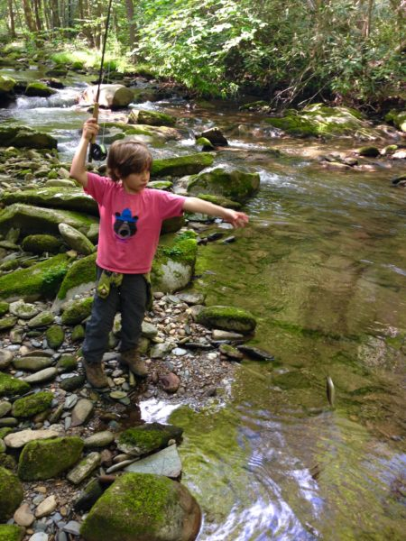 Our 6 year old son Boone lands a fish during a family hike along a small stream