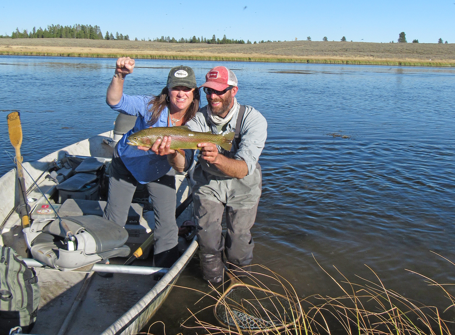 Charity is ecstatic after catching this incredible fish on a dry fly in just inches of water on the Ranch