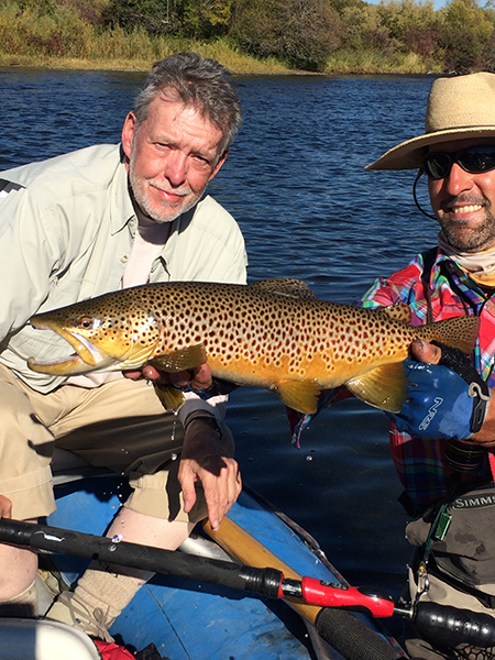 Fred is just a little too cool after landing this mega brown trout on a Zebra Midge